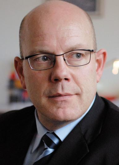 Dr. Michael Bütter.